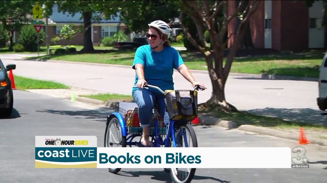 Teachers bringing Books on Bikes to students in Newport News on Coast Live