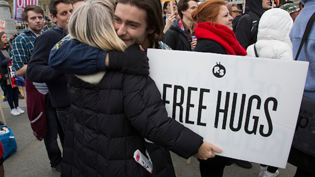 Woman upset by Trump victory spends day giving out free hugs