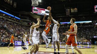 Miami Hurricanes guard Harlond Beverly goes up for basket vs. Florida State Seminoles in February 2020