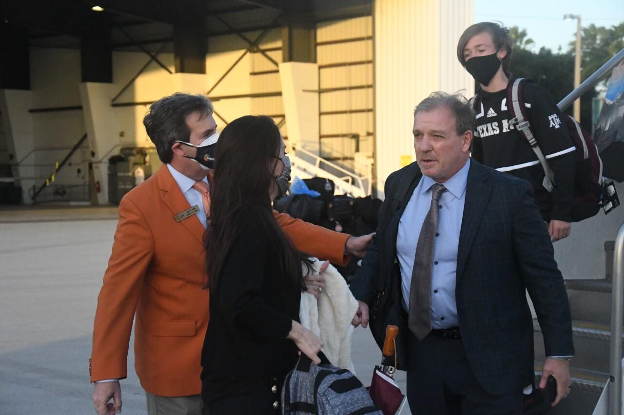 Texas A&M Aggies head coach Jimbo Fisher arrives at Miami International Airport ahead of Orange Bowl, Dec. 31, 2020