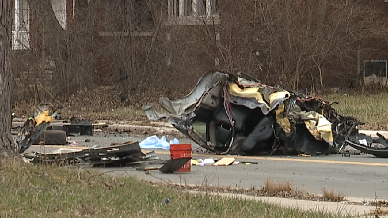 Car split in half after hitting telephone pole in Detroit double