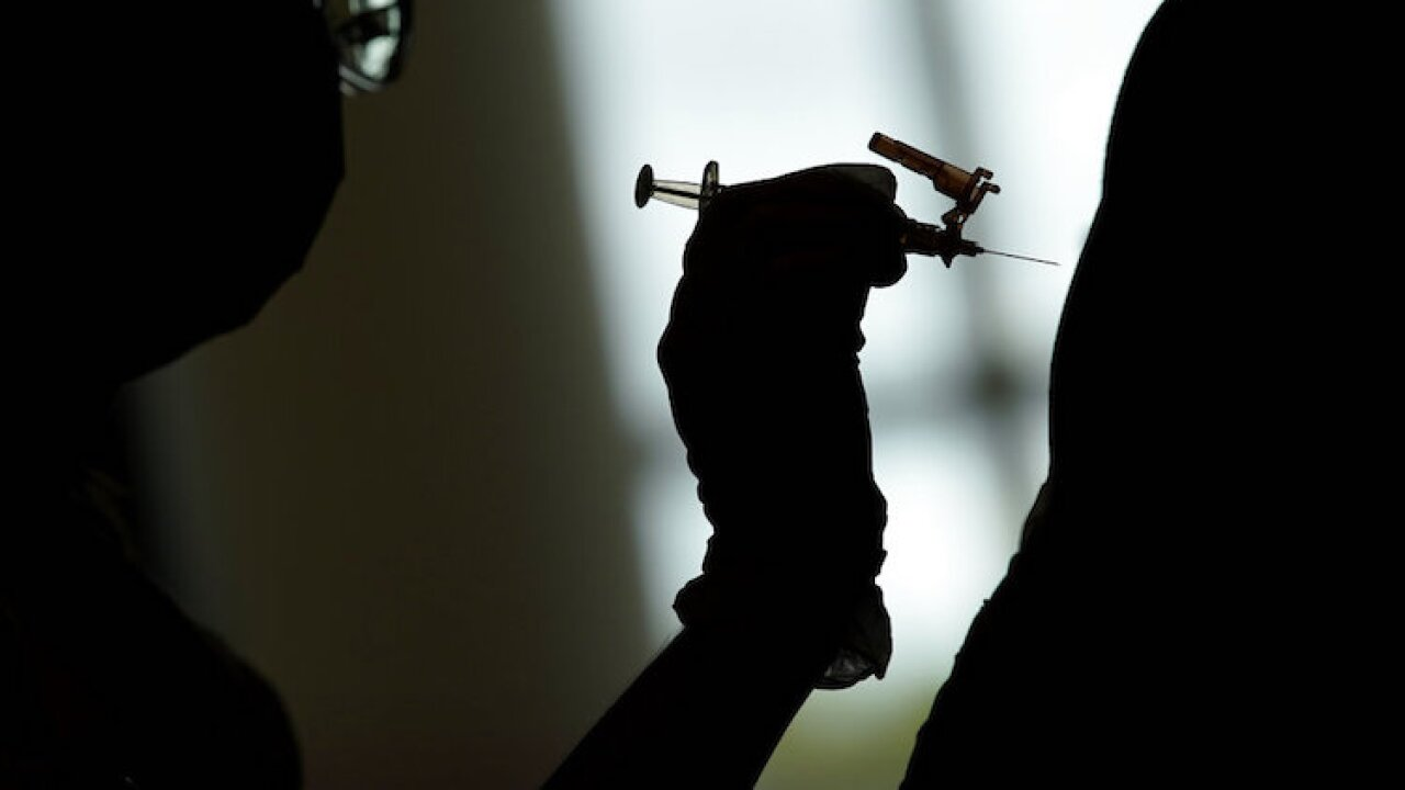 covid vaccine syringe shot