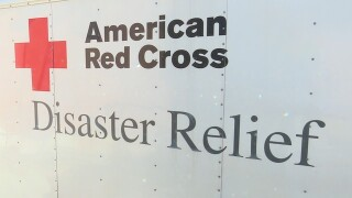 Two Red Cross volunteers leave Tucson to help...