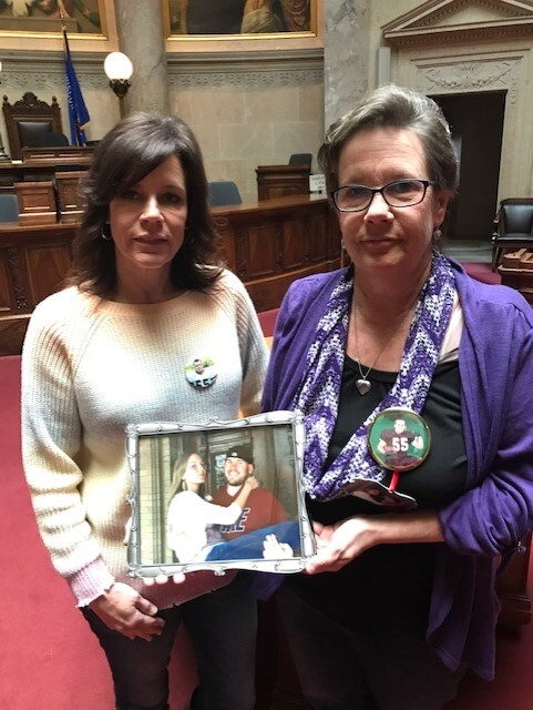 Caralee Butzine and Marla Hall hold a photo.