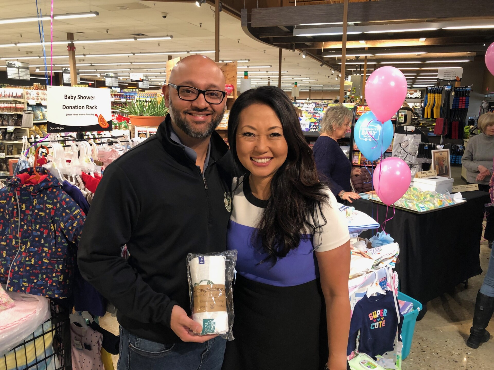 TODAY'S TMJ4's Susan Kim helps with donations for the Community Baby Shower