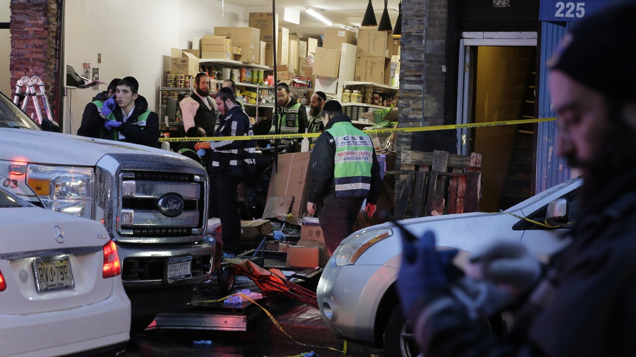 Pawn shop owner whose number was on Jersey City shooter arrested after rifles found on property: court docs