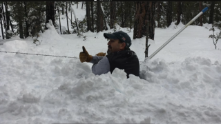 Valley man nearly buried by snow