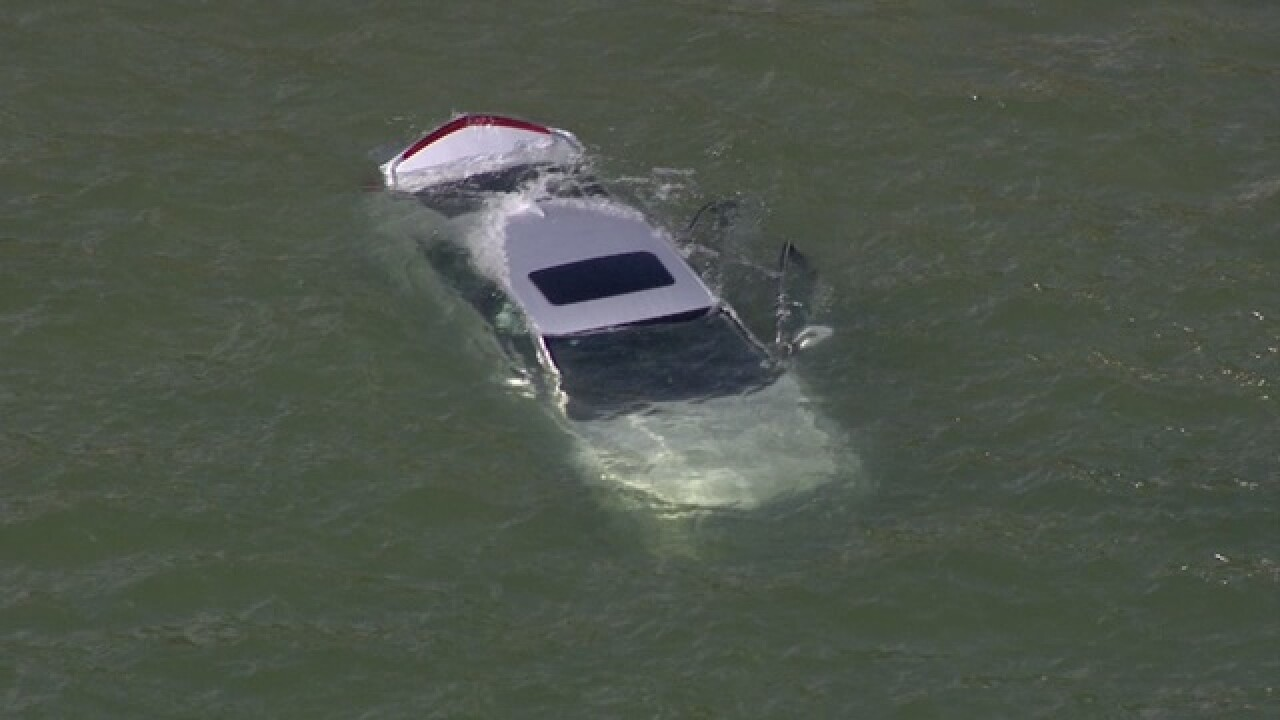 Car being pulled from Lake St. Clair