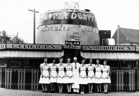 Louis_Ballast_owner_of_the_Humpty_Dumpty_Barrel_Drive_Inn_in_Denver_Colorado_poses_in_front_of_his_restaurant_during_the_1940s_with.jpg