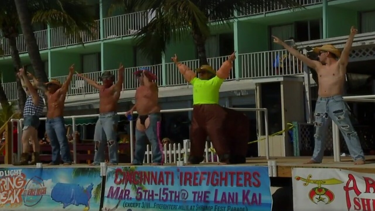 Dancing firefighters draw crowd on beach