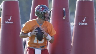 Tampa Bay Buccaneers QB Tom Brady prepares to throw during practice, Aug. 13, 2020