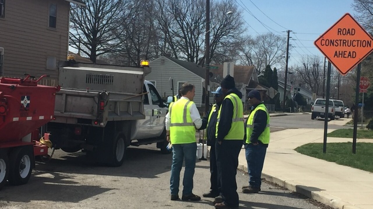 PHOTOS: Mayor helps fill potholes in Indy