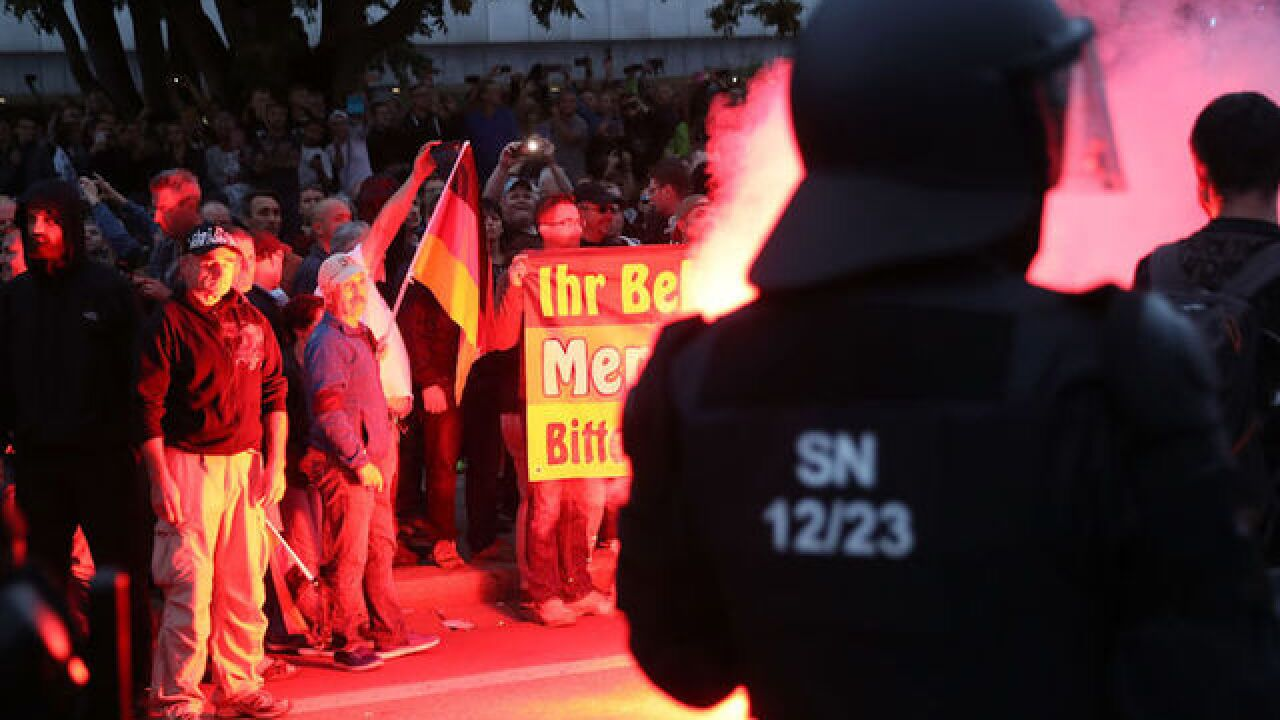 Thousands of far-right and anti-Nazi protesters clash over Chemnitz stabbing