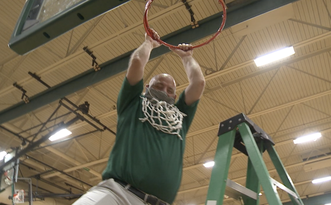 Nate Burns celebrates the conference crown