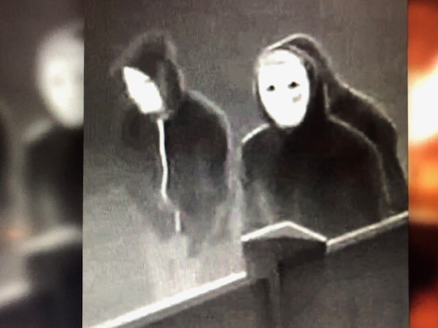 Mask wearing arson suspects