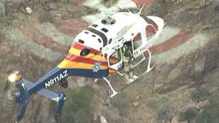 Helicopter rescues hikers stranded in Superstition Mountains
