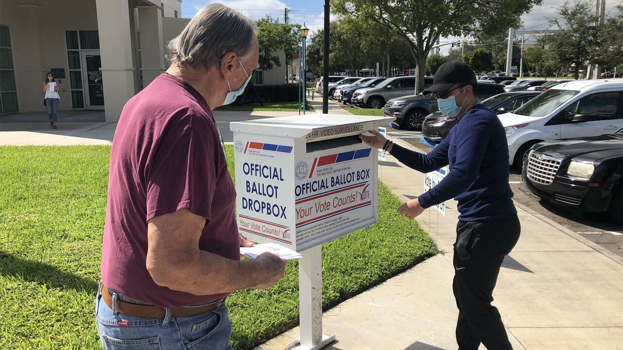 Palm Beach County voters drop off their ballots