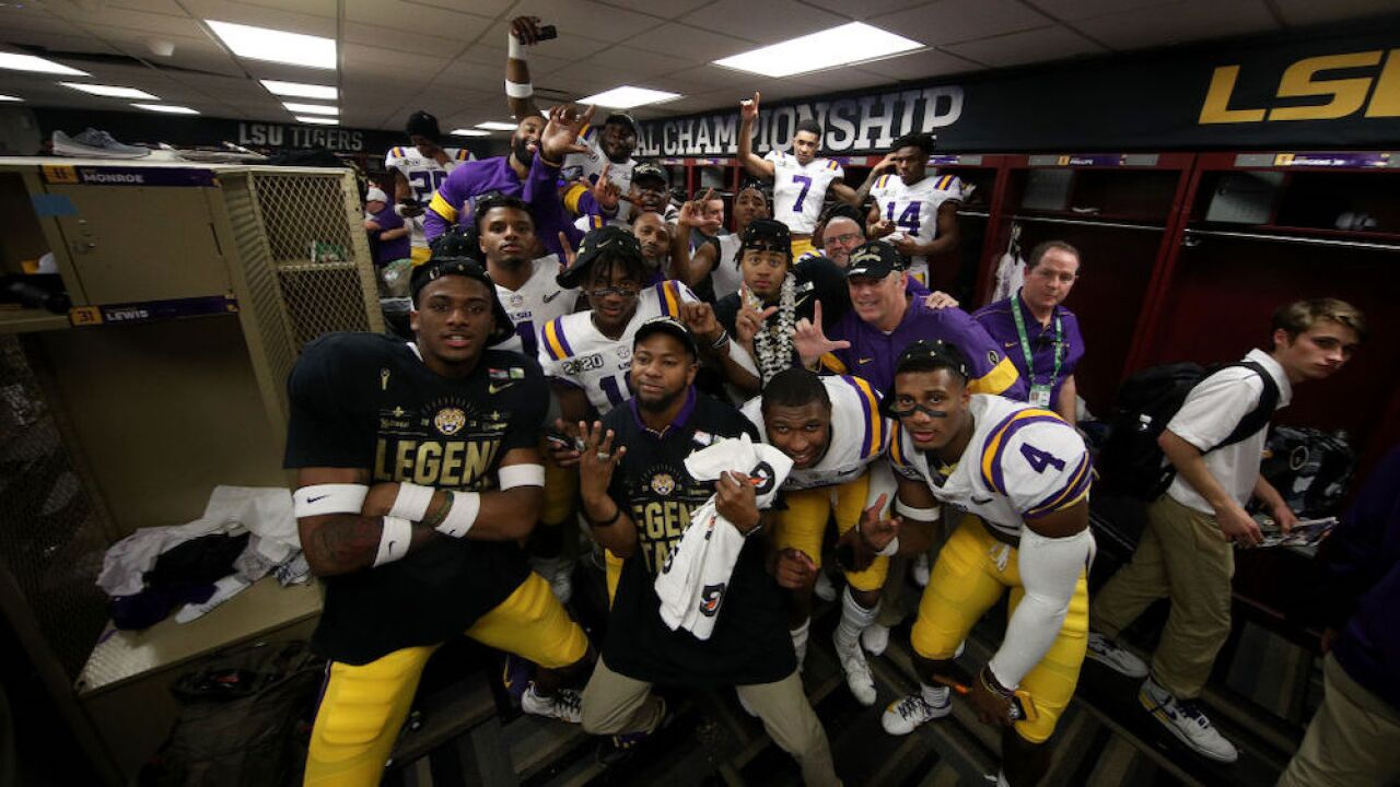 Officer threatens to arrest LSU football players smoking victory cigars in locker room, reports say