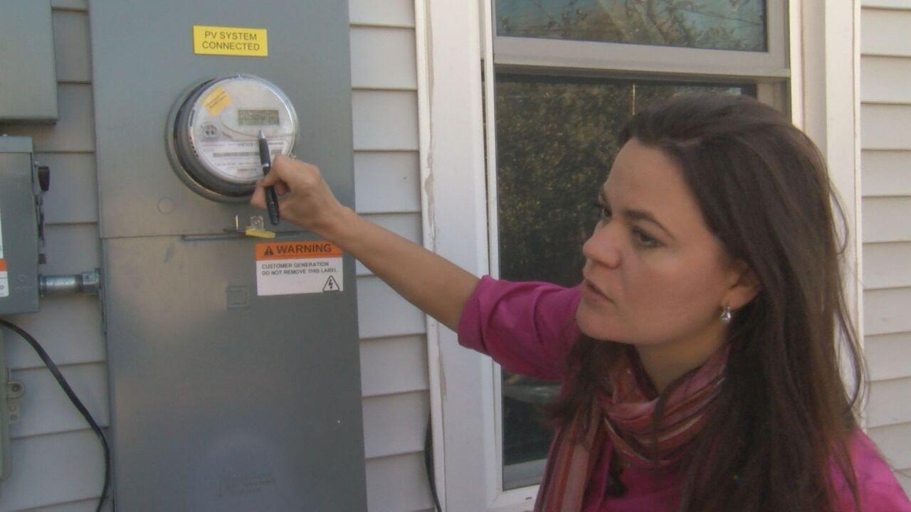 Nancy showing KOAA 5 her meter outside