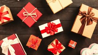 wrapped-gift-boxes-with-ribbons-on-table-1303080.jpg