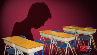 Depressed Student Over Desks