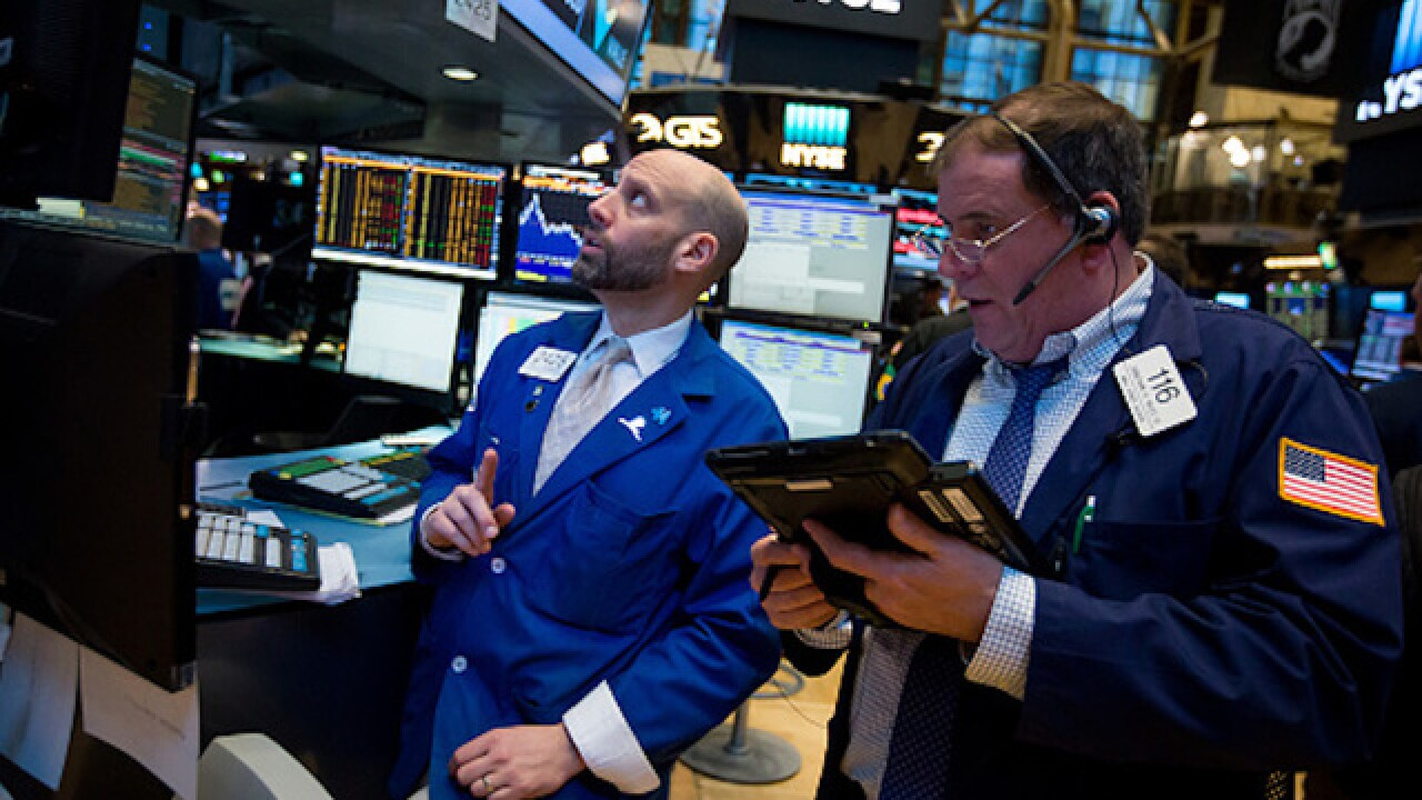 Dow soars 300 points, closes above 21,000 for the first time