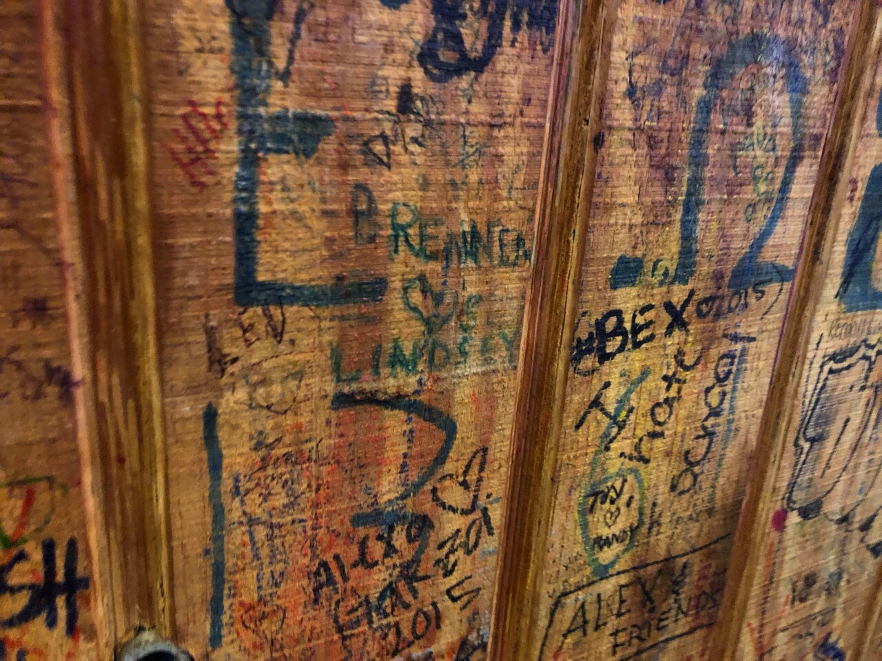 Graffiti covers every inch of the walls at the Brass Ring Pub in North Palm Beach.