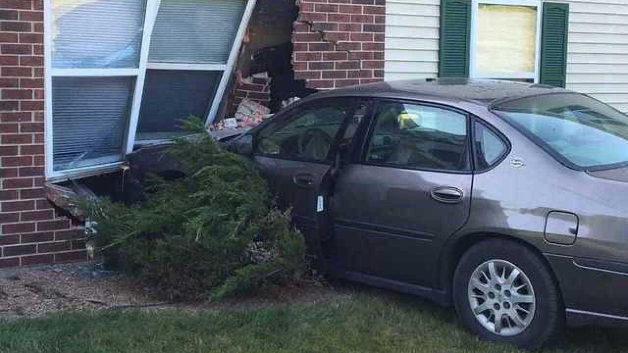 Fleeing car crashes into Kenosha apartment