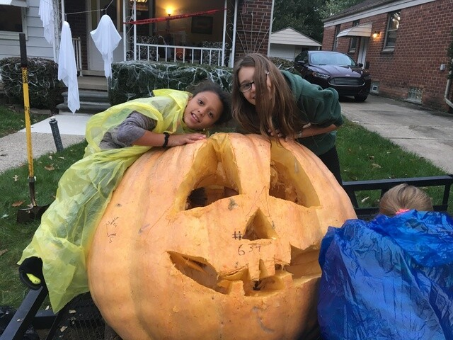 GALLERY: Dearborn family carves giant pumpkin in preparation for Halloween