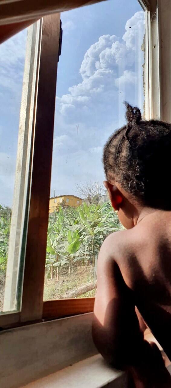 A child watches La Soufriere