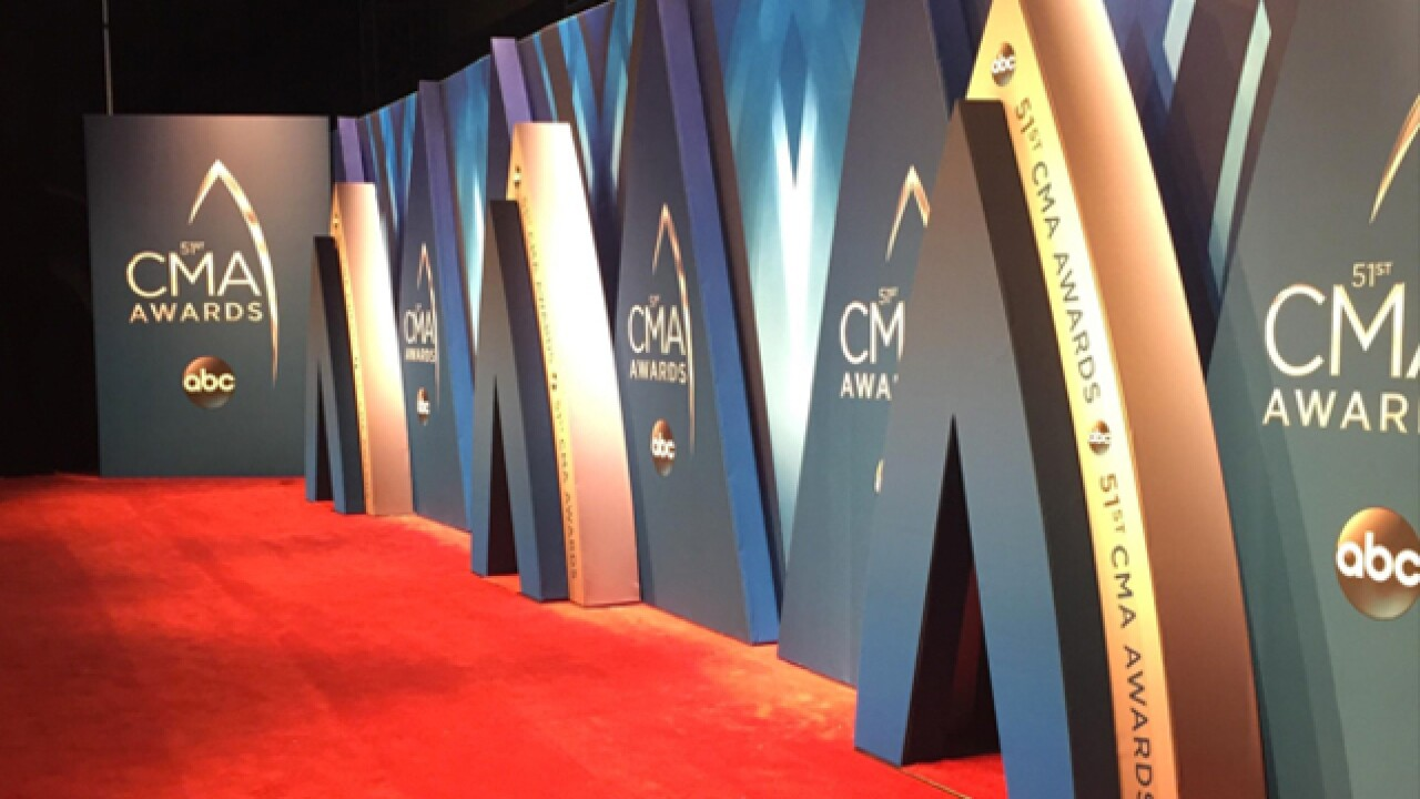 Country stars walk CMA Awards red carpet