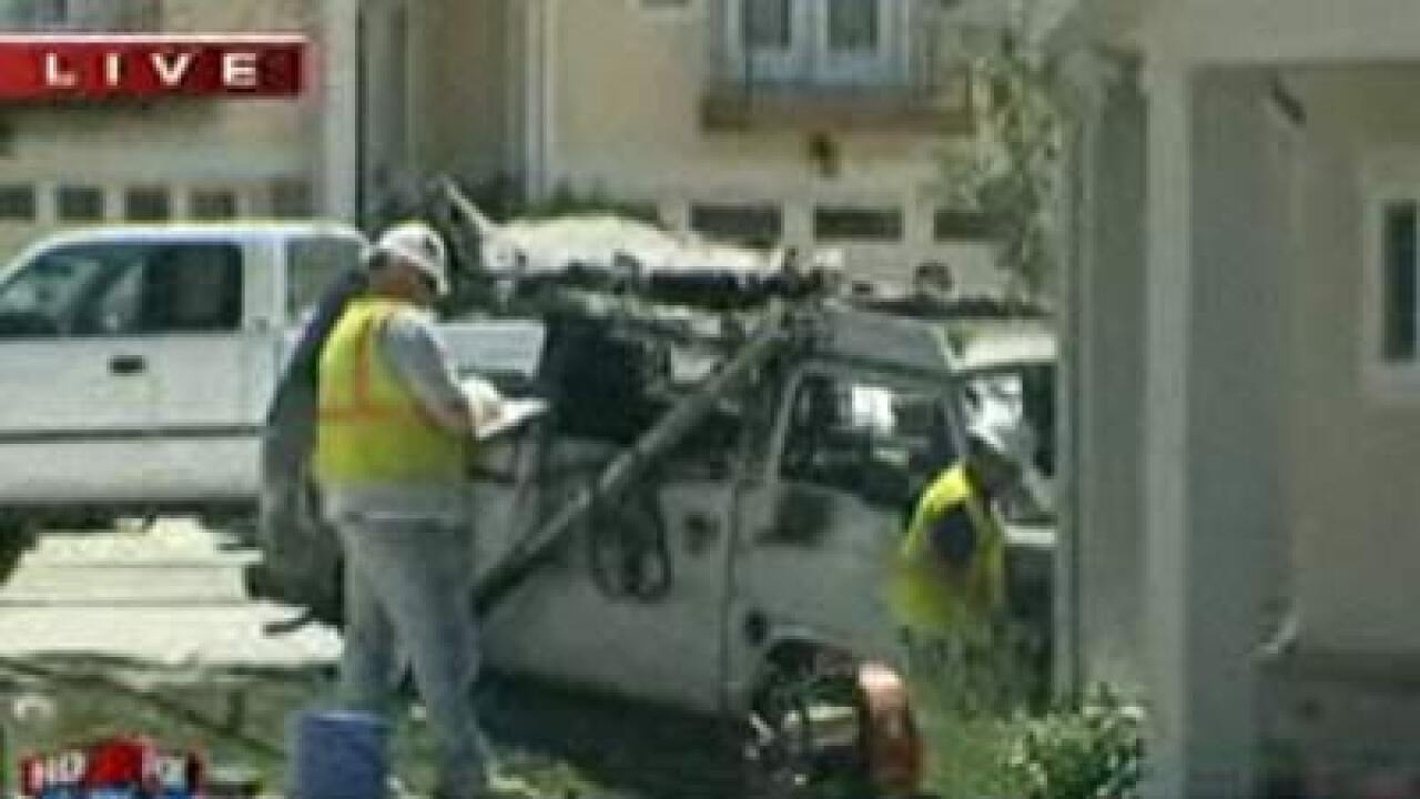 Parked van catches fire, rolls into home