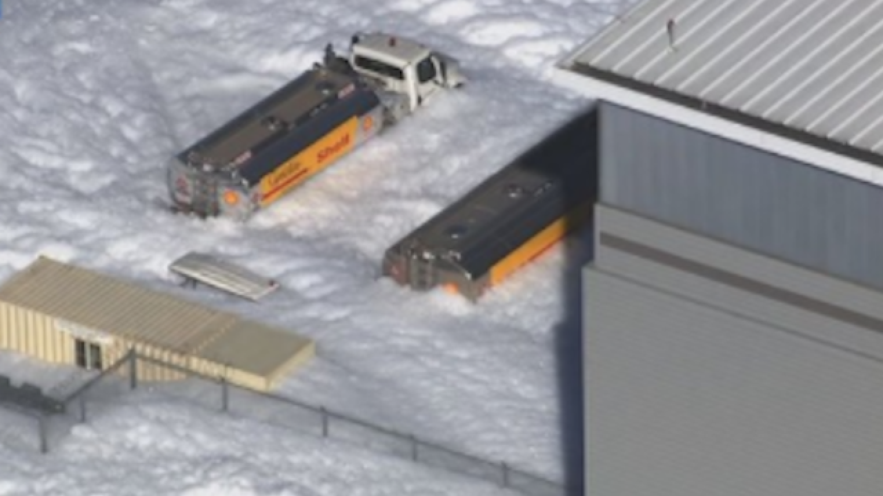 White foam spills out of airplane hangar and on to California streets