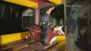 Kilgore police officer rides a mechanical bull