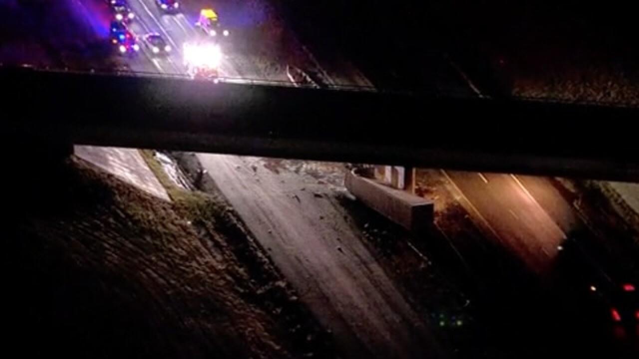 Semi crashes into bridge in Adams County