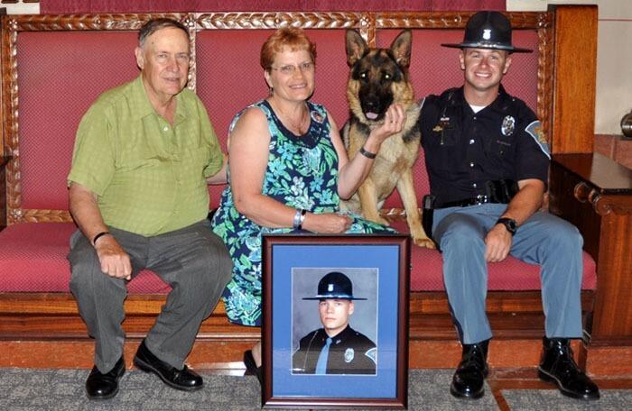 Barrett with family of fallen trooper.jpg
