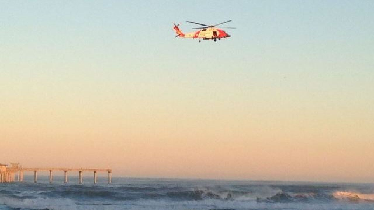 Searchers find no sign of a missing swimmer