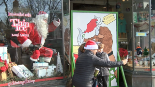 Santa gives selfies on Elmwood's Small Business Saturday