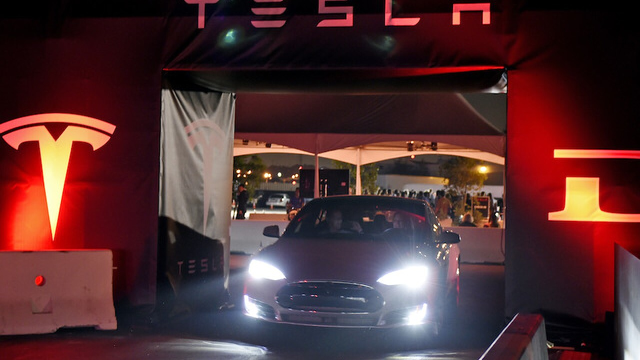 Tesla board member denies harassment claims