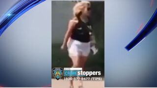 woman throws glass bottle at black jogger