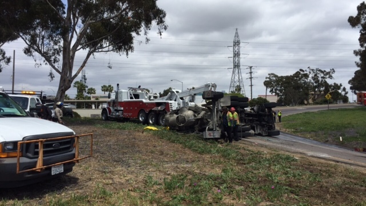 Overturned cement truck snarls I-805