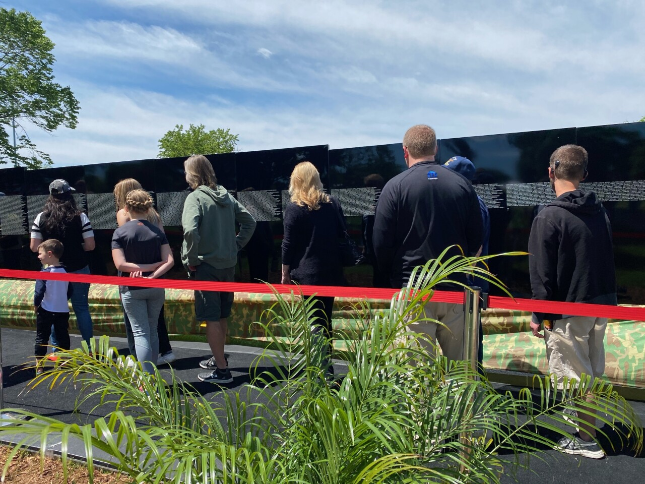 Visitors admire the moving wall exhibit in Waukesha prior to Memorial Day on Monday.