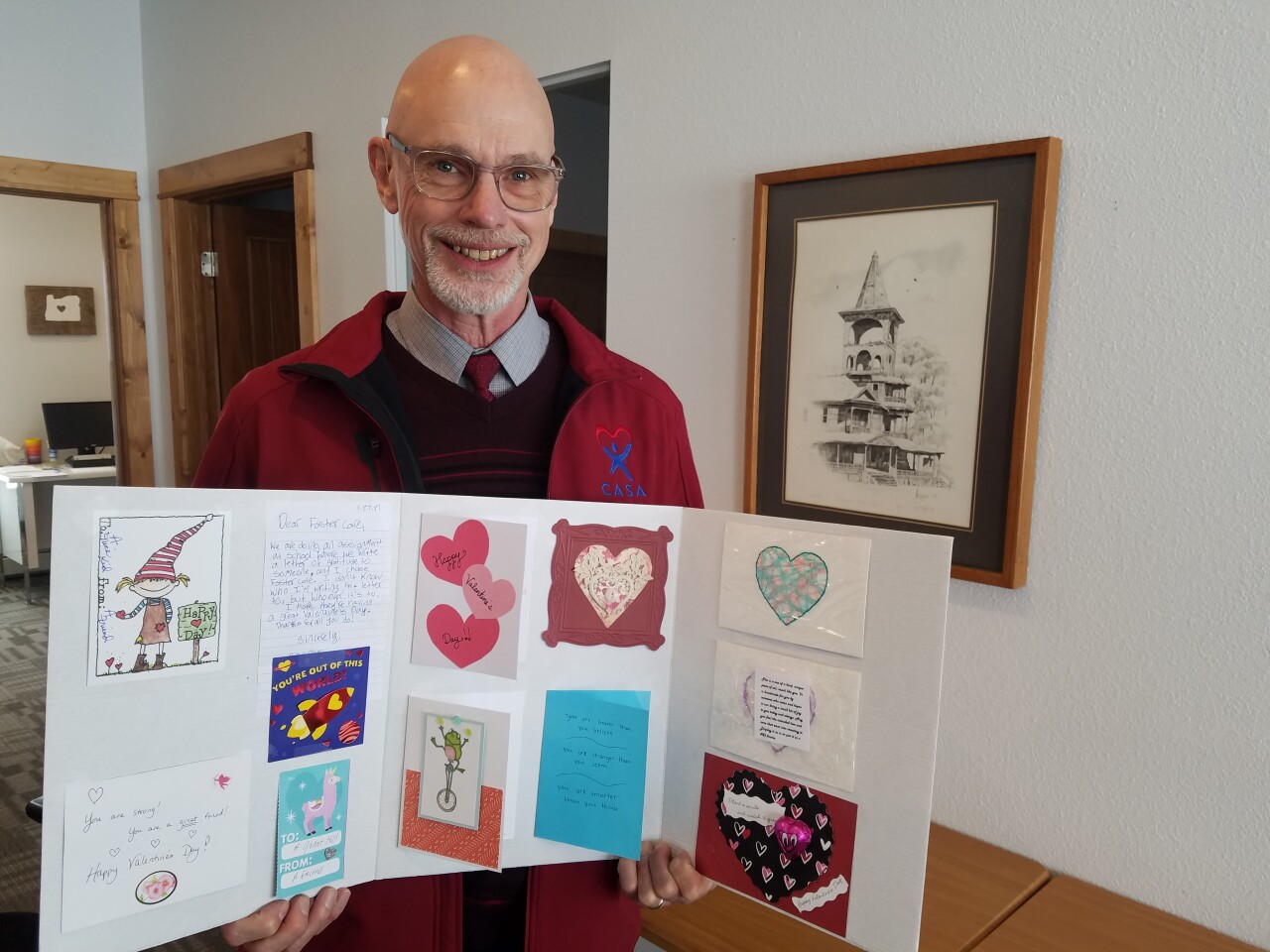 CASA Executive Director Gerry Hill with donated Valentine's Day cards