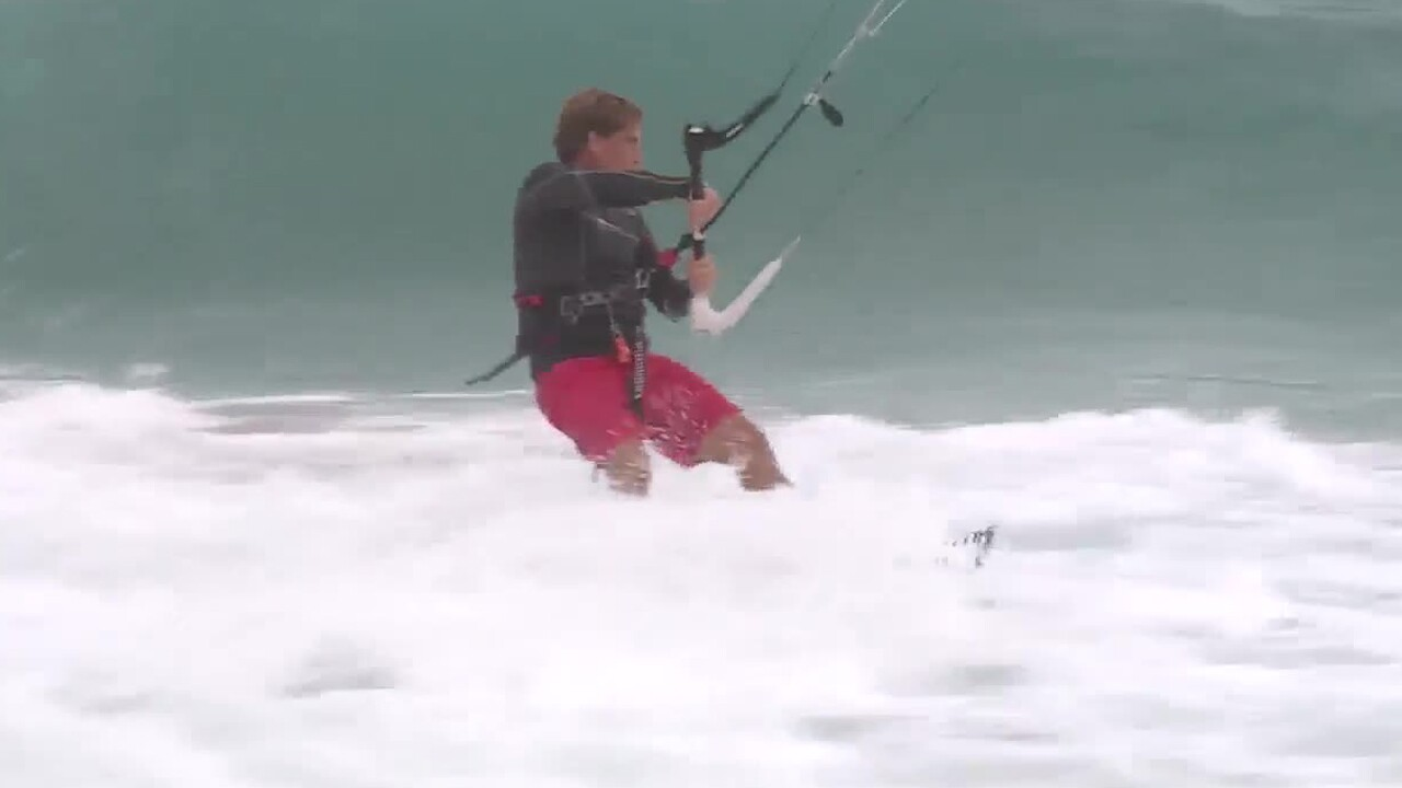 A kitesurfer rides the waves in Juno Beach on Aug. 1, 2020, ahead of Hurricane Isaias.