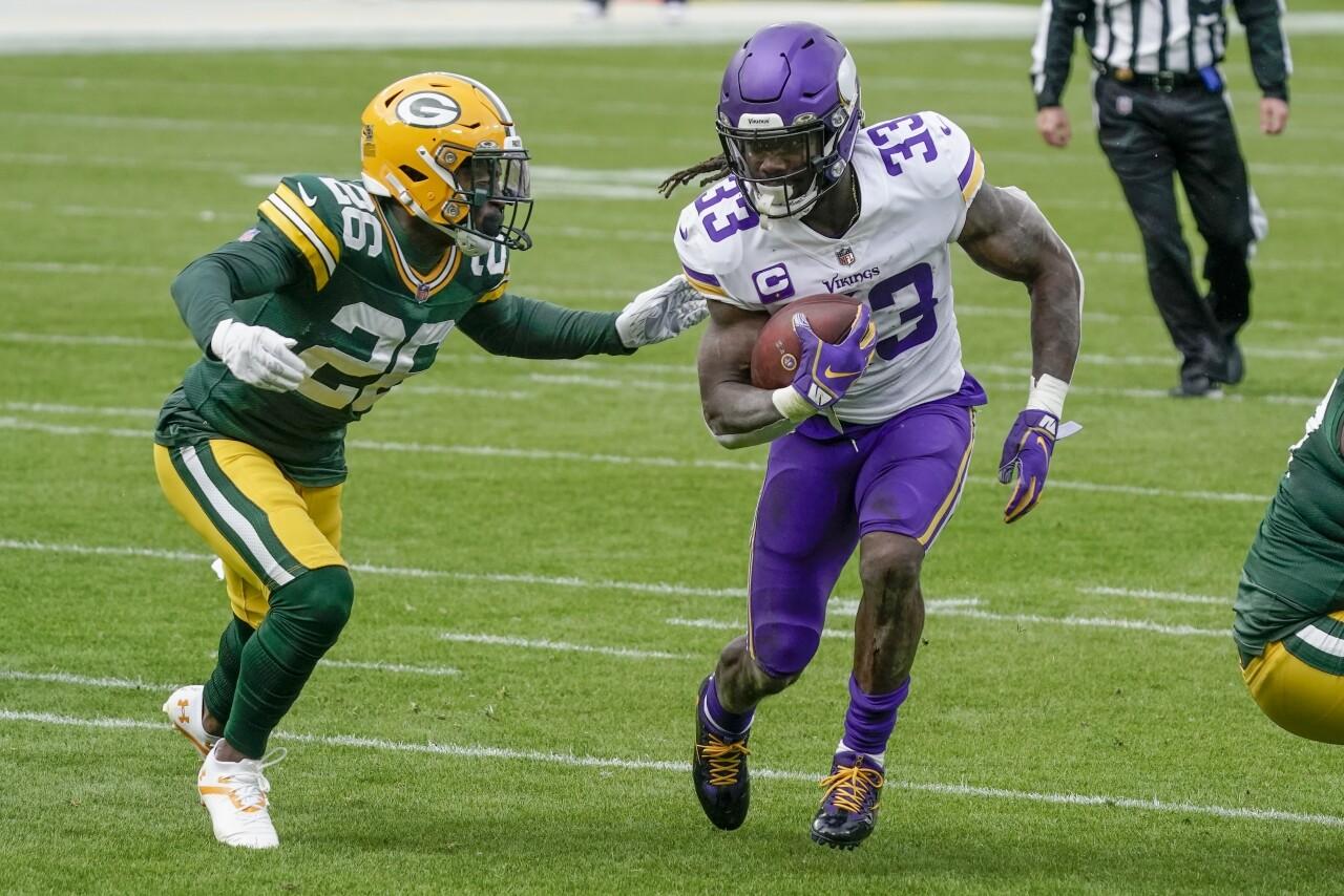 Minnesota Vikings running back Dalvin Cook runs past Green Bay Packers safety Darnell Savage, Nov. 1, 2020
