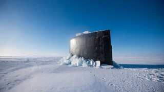 Photos: U.S. Navy submarines surface through ice in Arctic Circle