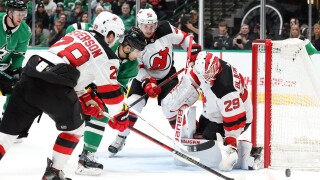 DALLAS, TEXAS - DECEMBER 10: Mackenzie Blackwood #29 of the New Jersey Devils makes a save in front of Andrew Cogliano #11 of the Dallas Stars in the first period at American Airlines Center on December 10, 2019 in Dallas, Texas. (Photo by Ronald Martinez/Getty Images)