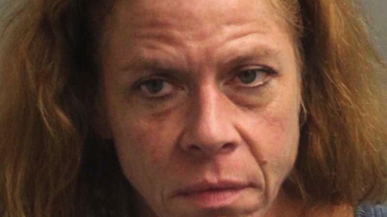 Woman arrested after drugs found in car