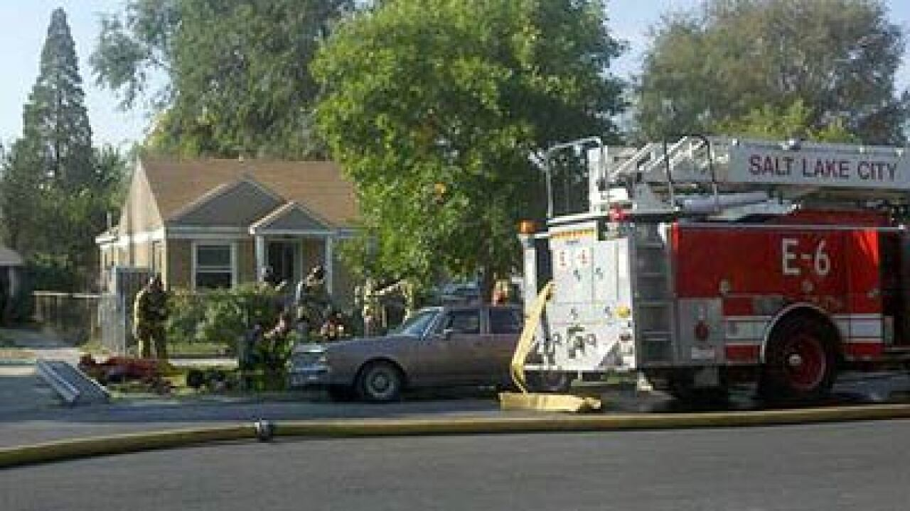 SLC house fire displaces family of three