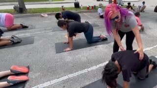 Lake Worth Community High School band director Tiffany Cox guides students through yoga on June 22, 2021.jpg